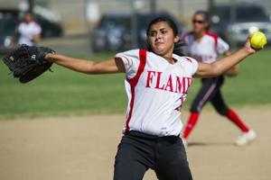 Softball: Late eruption lifts Flames