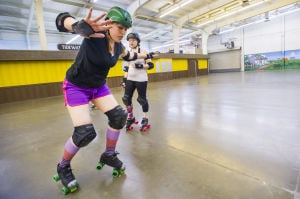 Reporter Skates After Her Derby Girl Dreams : News-Sentinel reporter Sara Jane Pohlman balances herself to keep from falling while skating with the Port City Roller Girls roller derby team at the San Joaquin County Fairgrounds on Thursday, Feb. 7, 2013.  - Dan Evans/News-Sentinel
