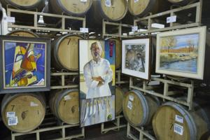 Elaborate art show unfolds in industrial barrel room