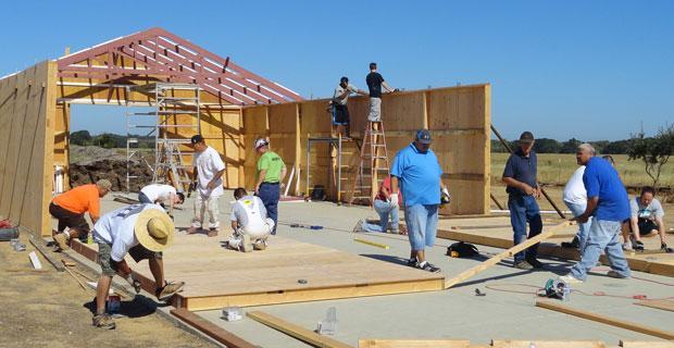Mormon volunteers help build new barn