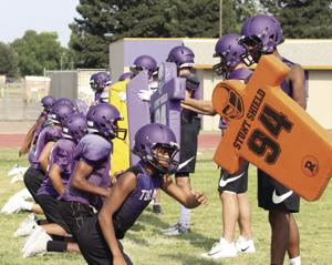 High school football: Tigers moving to a different beat