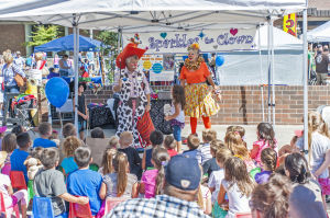Little Buckaroos Saddle Up To Read At The Reading Roundup : Ravioli and Sparkles the clowns put on a magic show during the second annual Little Buckaroos Reading Roundup Literacy Fair, hosted by the Lodi News-Sentinel and the Lodi Public Library, on Locust Street in Downtown Lodi on Saturday, Aug. 24, 2013. - Ian Jonsson/News-Sentinel