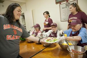 Nursing home residents make meals for needy