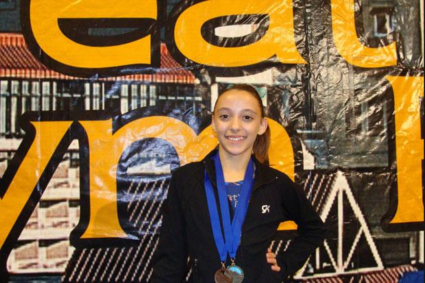 Lxana DeGrandmont earns Double Gold at Great West Gym Fest competition