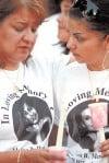 Candlelight vigil for Mendoza draws 100