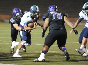 High school football: Tigers hang tough, but Knights prevail