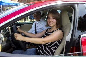 Father's Day Tesla test drive sparks interest at Lucas Winery