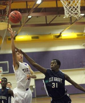 Boys basketball: Tigers edge Thundering Herd