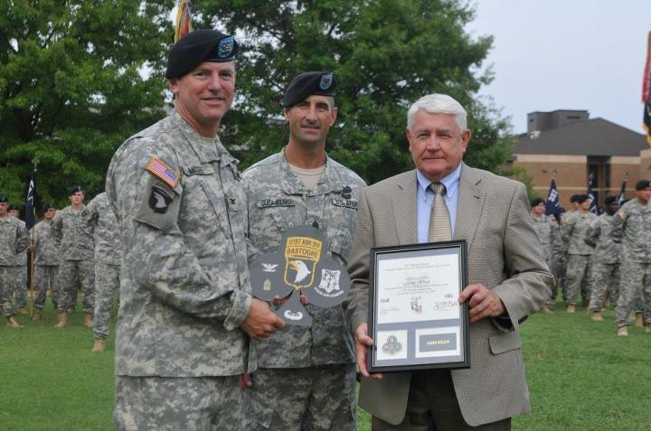 Jim Wilson accepts the honor of Distinguished Member of the Regiment