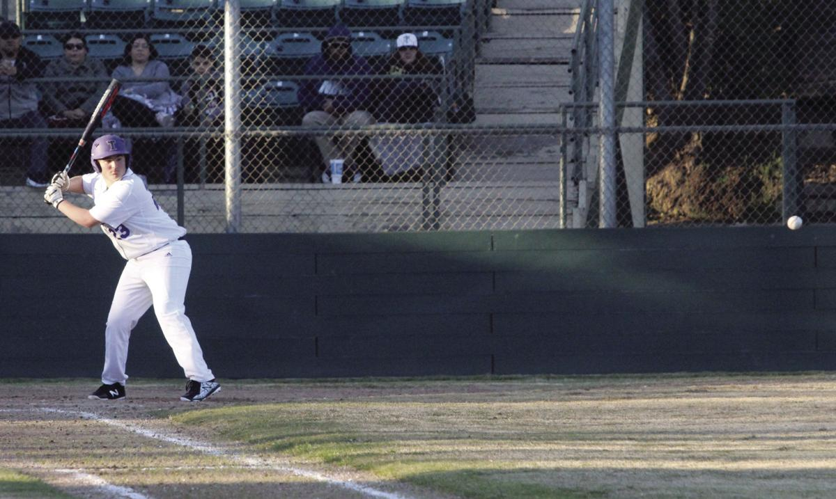 High school baseball: Tigers fall in home opener