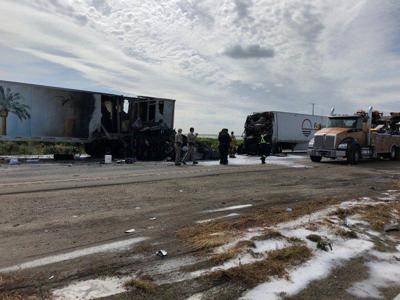 Fatal accident involving several big rigs shuts downs