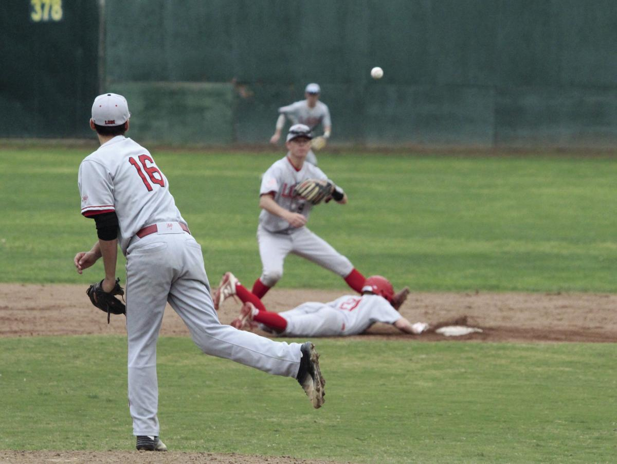 Baseball: Flames beat Trojans in extra innings