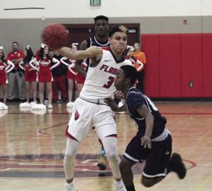 Boys basketball: Flames fall to West in OT