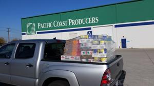 Nearly 100 cases of donated tomato and fruit product from Pacific Coast Producers in Lodi