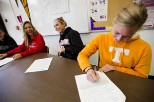 Local athletes signed, sealed and delivered