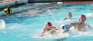 Flames get defensive in boys water polo win over Trojans