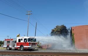 Firefighters face 100-degree heat