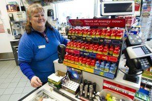 Holiday Grind: Locals Share Motives For Working On Christmas: Cathy Huber helps a customer while working at Chevron on Christmas Day.  - Dan Evans/News-Sentinel