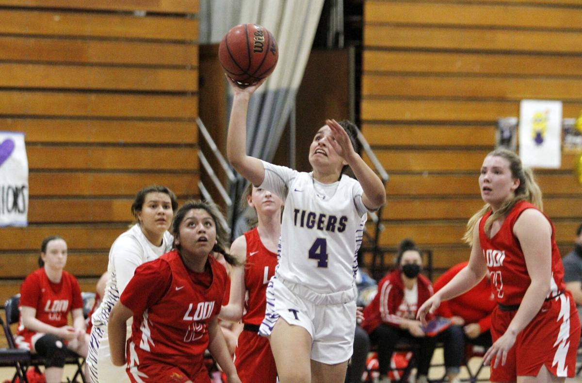 High school roundup: Flames pull away late to beat Tigers in girls hoops