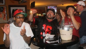 San Francisco 49ers Fans' Emotions Went Up And Down During Super Bowl: From left, Michael Deloach of Stockton, Polito Maldonado of Galt and Matt Pesce of Lodi root the San Francisco 49ers on after quarterback Colin Kaepernick completes a pass deep into Ravens' territoryduring the Super Bowl on Sunday, Feb. 3, 2013. Maldonado is bar manager of The Stadium, which hosted a Super Bowl party.  - Ross Farrow/News-Sentinel