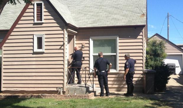 Police search home and backyards for man and woman