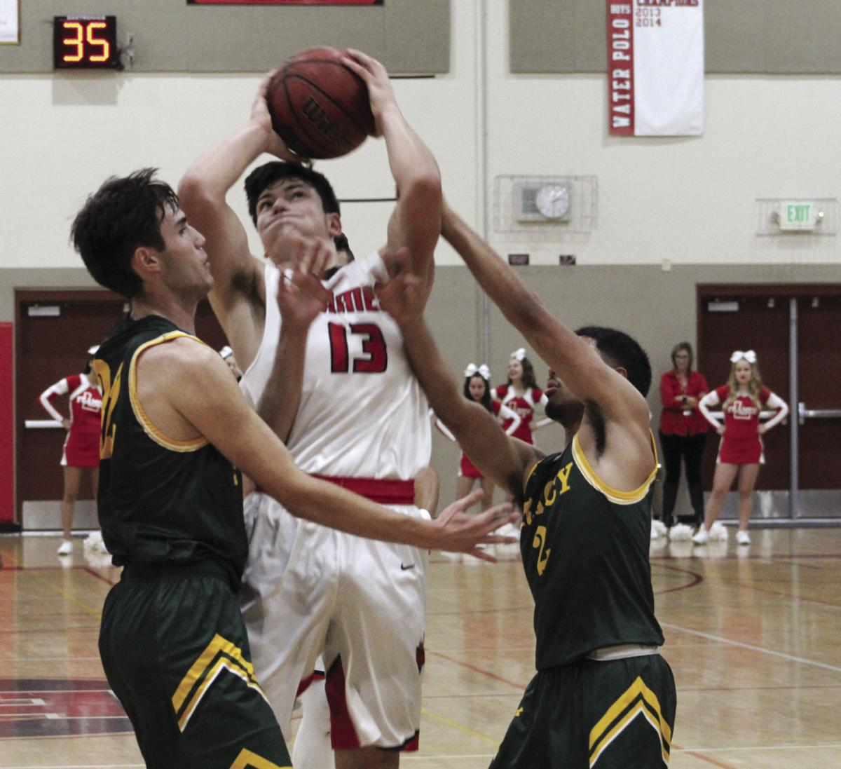 Boys basketball: Flames' turnovers let the 'Dogs out