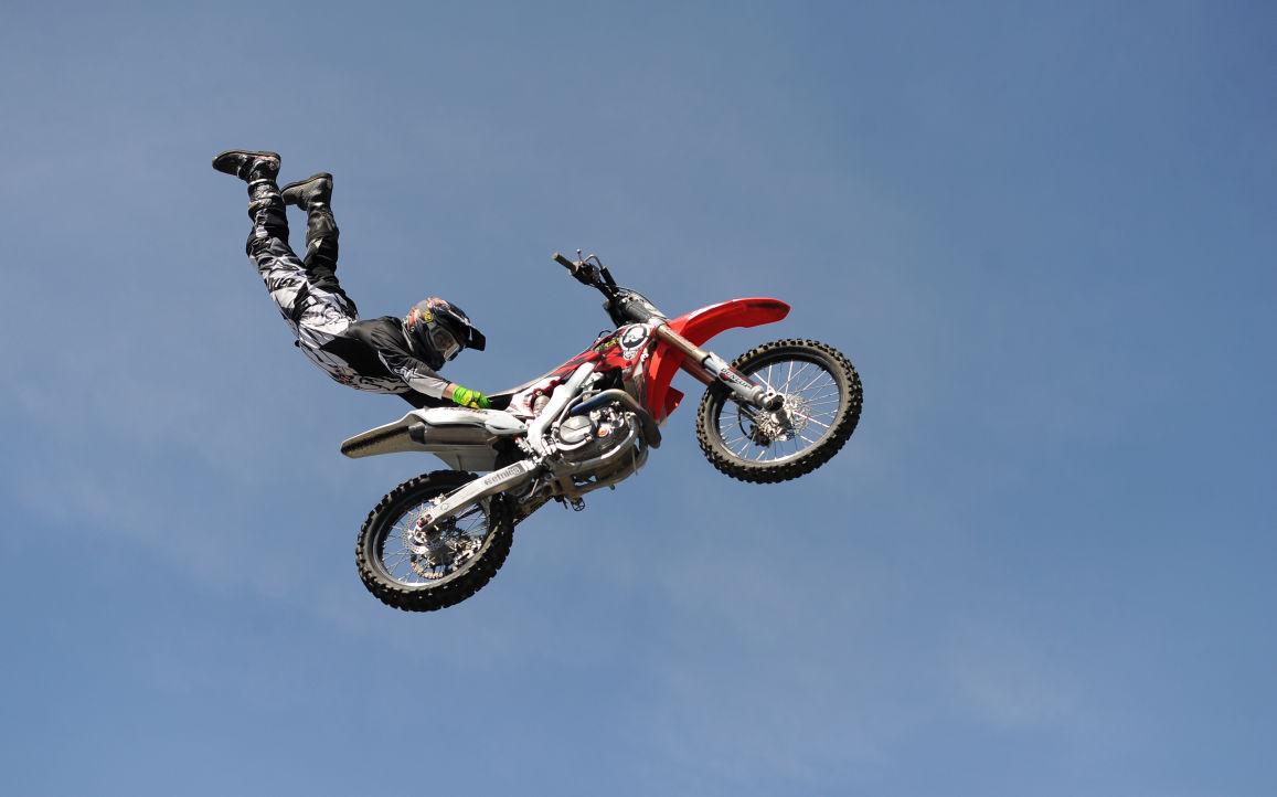 Metal Mulisha freestyle motocross riders do backflips for