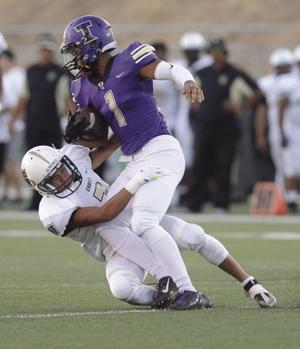 High school football: Tigers drilled by Titans