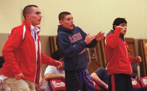 Wrestling: Clutch win keeps Flames in line for a three-peat