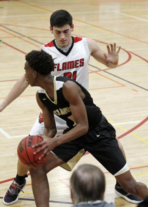 Boys basketball: Flames beat Titans in the paint