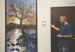 Painting dedicated in honor of late Rowland Cheney