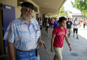 Campus supervisor Gary Cooper keeps Tokay High School students in class, on right path