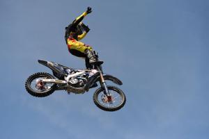 Metal Mulisha freestyle motocross riders do backflips for Napa Auto Parts opening