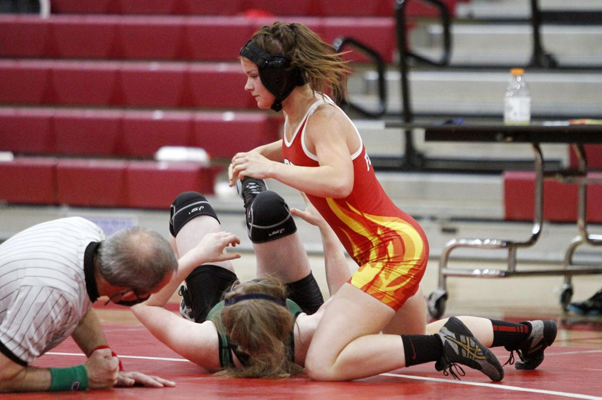 High school roundup: Flames' boys and girls wrestlers take down Bulldogs