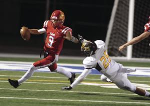 High school football: Flames falter against Vikings