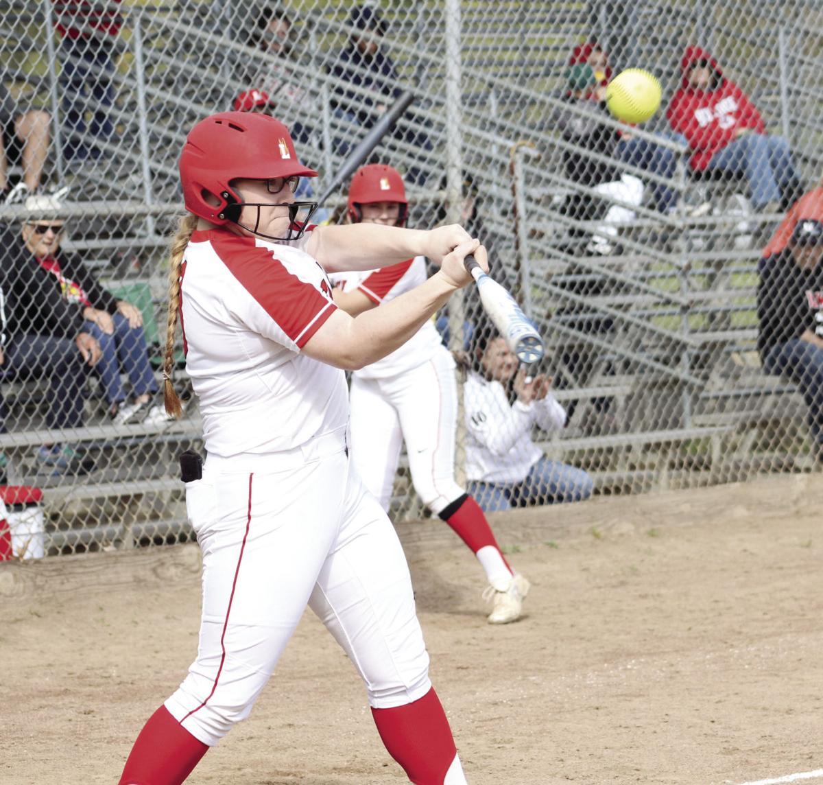 High school softball: Tigers' bats cool off the Flames