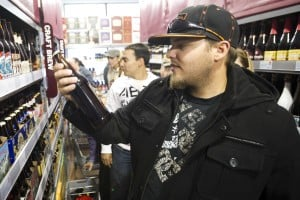 BevMo! Opens In Lodi : John Delp of Lodi examines a bottle of Red Rocket Ale before placing it in his basket at BevMo! on Kettleman Lane in Lodi on Friday, Nov. 9, 2012.  - Dan Evans/News-Sentinel
