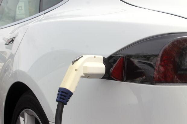 Electric cars spark local development, charging stations