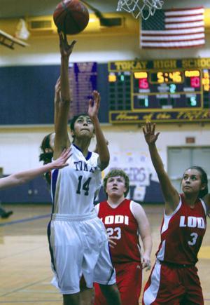 Girls basketball: Tigers stifle Flames