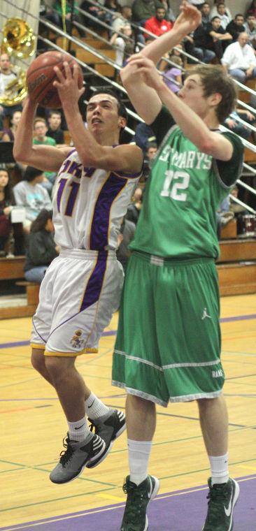 Boys basketball: Tigers hang tough for a half, but Rams pull away