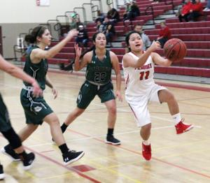 Girls basketball: Time on Flames' side in TCAL-opening victory