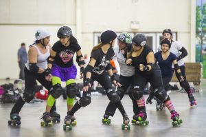Reporter Skates After Her Derby Girl Dreams : Members of the Port City Roller Girls roller derby team scrimmage during practice at the San Joaquin County Fairgrounds at the San Joaquin County Fairgrounds on Thursday, Feb. 7, 2013.  - Dan Evans/News-Sentinel