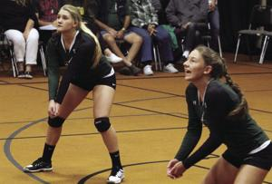 Volleyball: Eagles split league matches