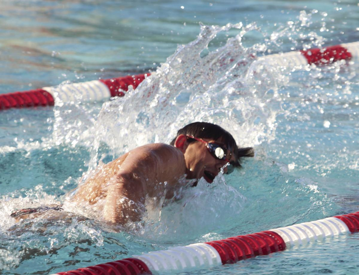 Swimming: Flames cruise to solid victory against St. Mary's