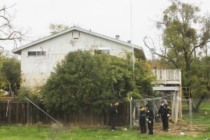 Animal Control: A Job With Few Protections: Detectives search the backyard of Joseph Corey's former home in Galt on Thursday, Nov. 29, 2012. Police said Corey shot and killed an animal control officer around noon on Wednesday, Nov. 28, 2012.  - Maggie Creamer/News-Sentinel