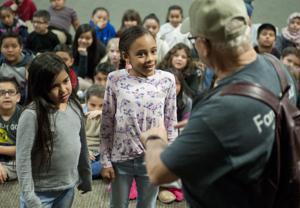 Lodi Police volunteers teach students about stranger danger