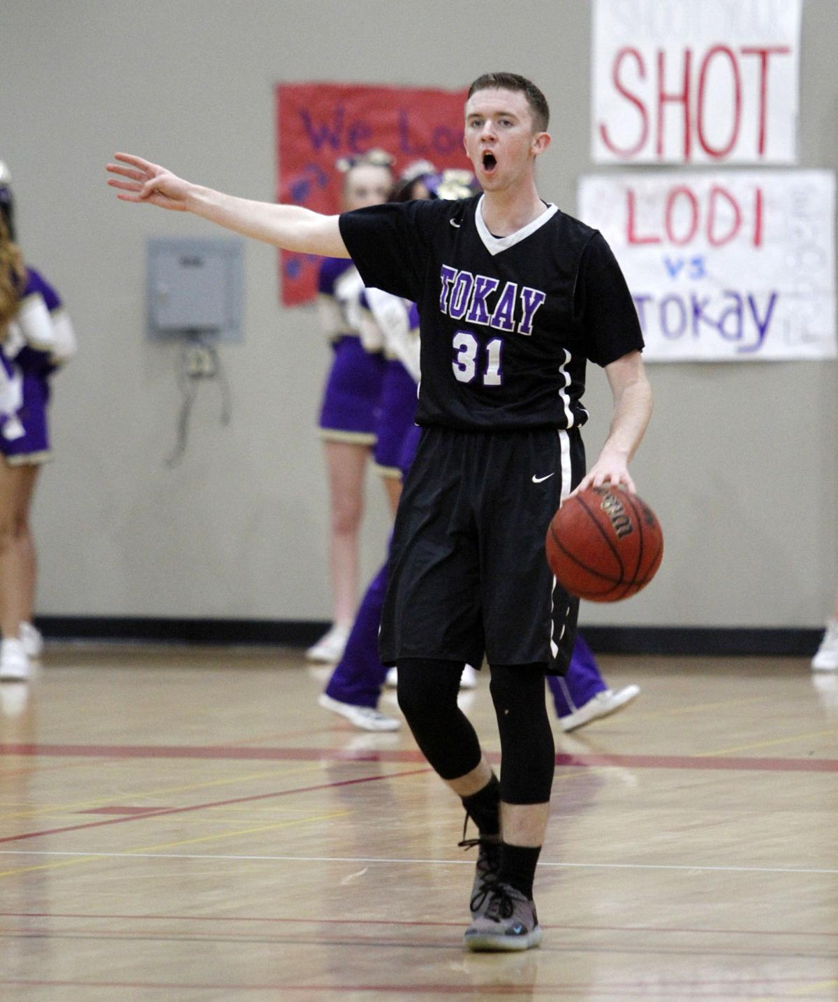 Boys basketball: Flames too much for Tigers