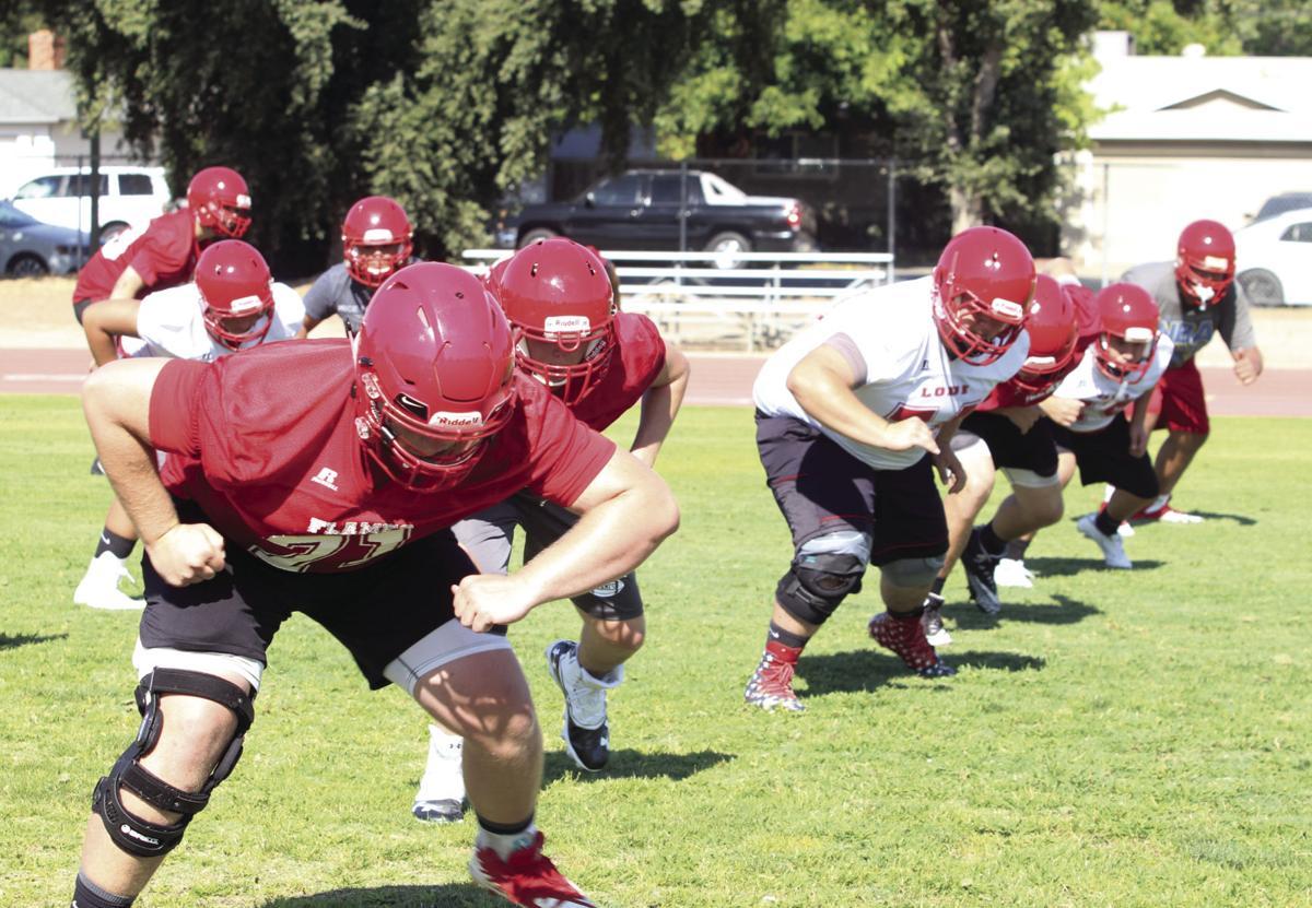 High school football: Practices begin for area teams