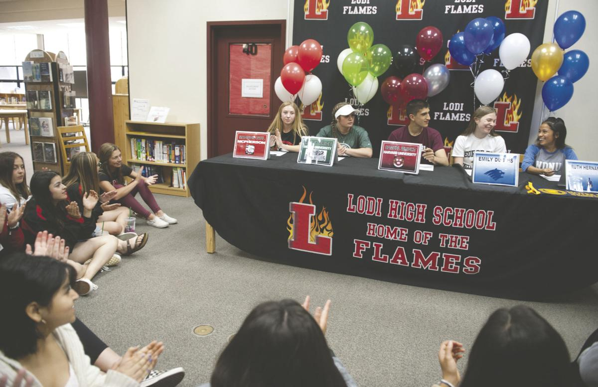 Lodi athletes ink agreements to play in college