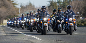 Fallen Galt Police Officer Kevin Tonn Laid To Rest : Dozens of motor officers lead a processional to the graveside service of Galt Police Officer Kevin Tonn on Monday, Jan. 21, 2013.  - Dan Evans/News-Sentinel